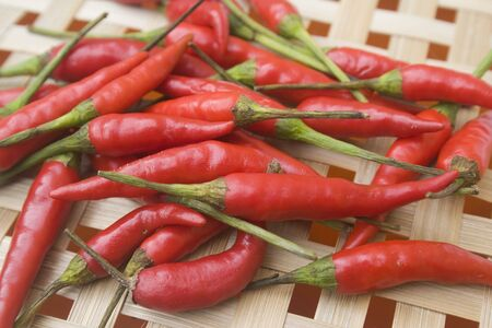 Chili peppers on basket photo