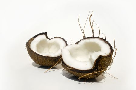 Broken coconut isolated on white Stock fotó
