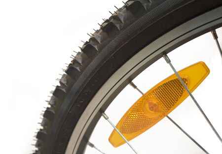 Close-up of a mountain bike tyre with reflector