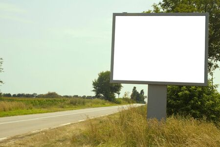 Deserted road with white billboard photo