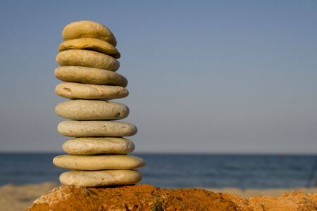 Nicely stacked tower of rocks on beach Stock Photo