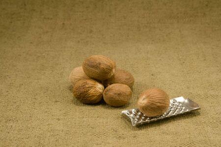 Whole nutmeg fruits on burlap