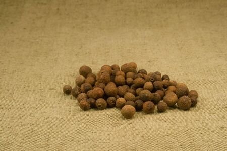 sackcloth: Allspice fruits on burlap