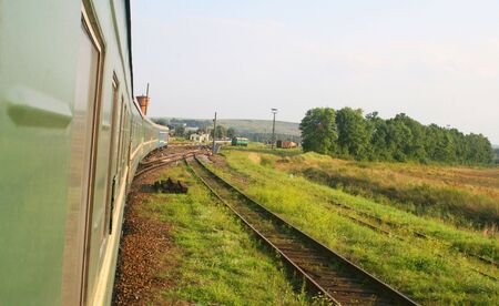 goods train: Eastern european train in countryside Stock Photo