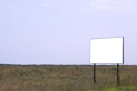 posting: Empty field with white billboard on side of frame