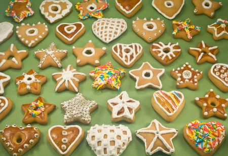 Decorated star and heart cookies on green paper Stock Photo