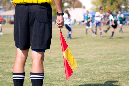 Girls football soccer referee watching over a game