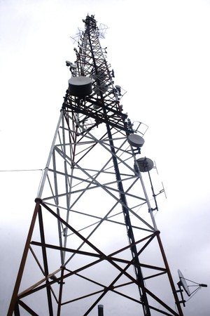 Single communication tower isolated against overcast sky