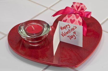 Red metallic heart dish with red candle in holder and valentine sachet with card