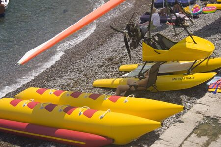 watercraft: Beach filled with watercraft for rental