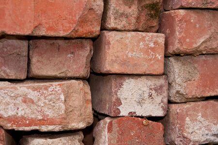 Pile of used bricks in closeup