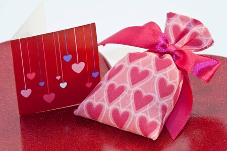 Red metallic heart dish with heart sachet with card
