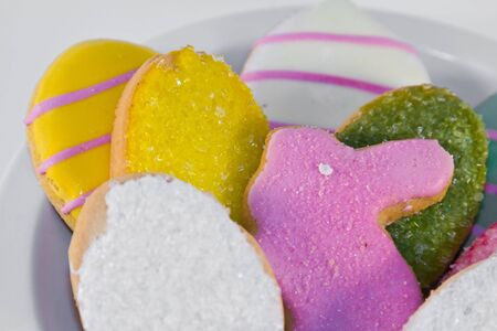 plateful: Plateful of iced Easter cookies against white background
