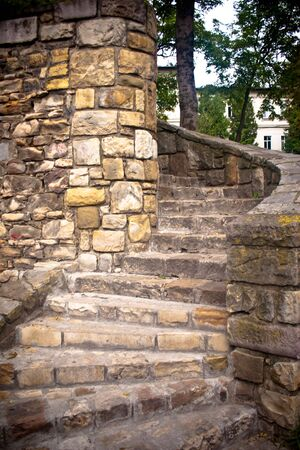 Beautiful twisted stone block staircase leading up into the unknown photo