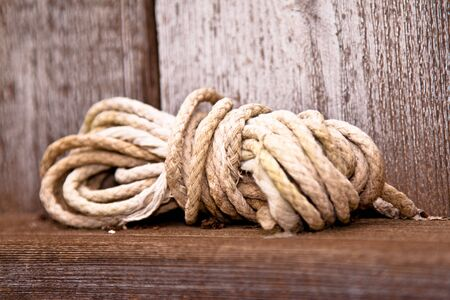 Ball of white twine cord ball wooden ledge photo