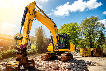 Excavator at construction site demolition detached house Stock Photo