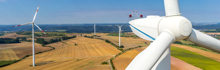 Banner aerial view and close-up of a wind turbine 写真素材