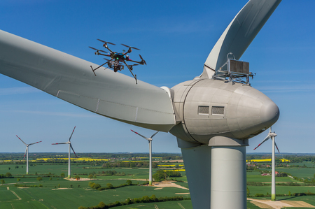 Drone during maintenance and inspection of a wind turbine aerial view Archivio Fotografico
