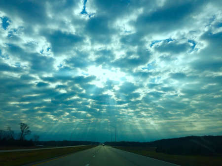 silver: The sun shining through the silver lined clouds to make a good day