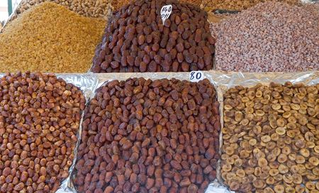 Dried fruit and nuts: dates, figs,  almonds, raisins in a moroccan market stand Stock Photo
