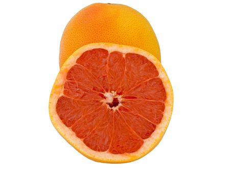 Fresh whole and halve pink grapefruit close-up isolated