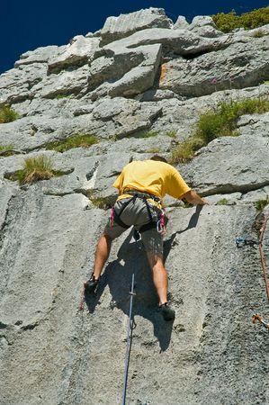 crack climbing: Rock climber climbing limestone, Switerland