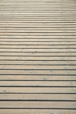 Wooden planks from a pier showing perspective