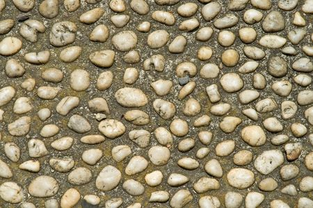 White marble pebbes forming polished cobblestone path