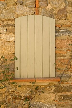 Old Window With shutters and Stone Wall Stock Photo