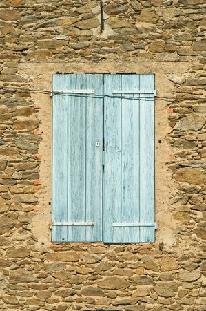 Old Window With shutters and Stone Wall photo