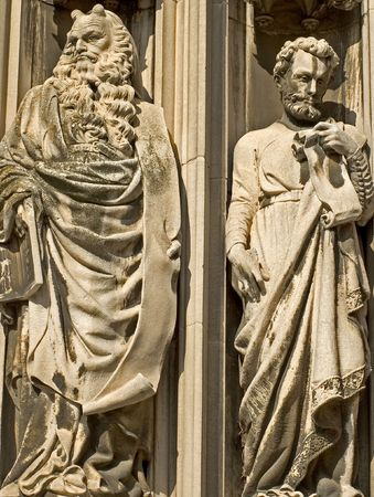 Two Carved marble statues of religious figures