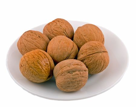 Plate of walnuts, isolated Stock Photo
