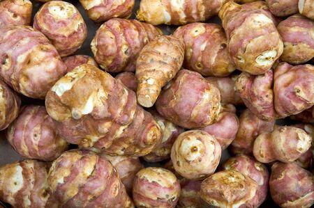 Fresh Jerusalem Artichokes (sunroot, sunchoke) in market
