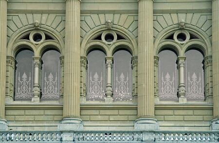 Three Beautiful Arch Windows with stone columns photo