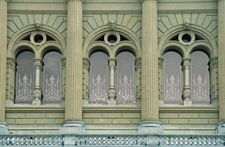 Three Beautiful Arch Windows with stone columns Stock Photo