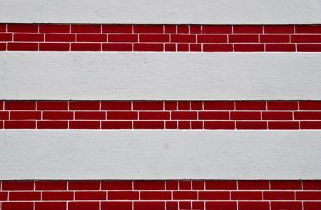 redbrick: Outside wall with red-brick layer and white concrete Stock Photo