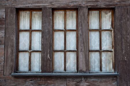 Old Windows in Wooden Frame from a traditional Swiss Chalet photo