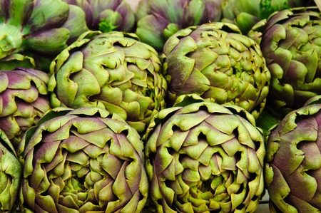 Lots of fresh globe Artichokes in a market stand