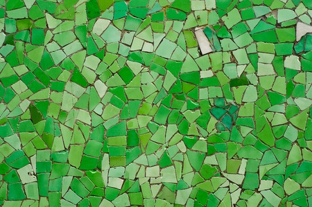 Mosaic of random broken green wall tiles photo
