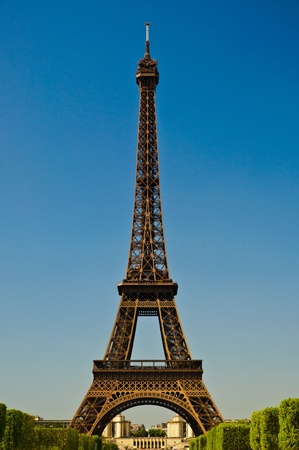 Eiffel Tower in portrait orientation with blue sky