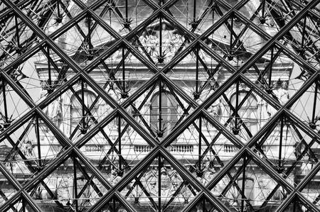 Black and white photo looking through the Louvre pyramid