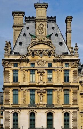 Front of an attractive old building at the Louvre, Paris