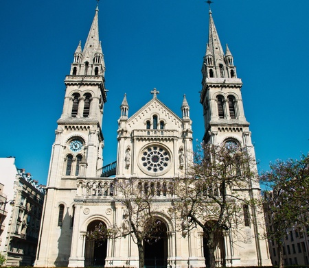 steeples:  St-Ambroise Church in Paris with blue sky