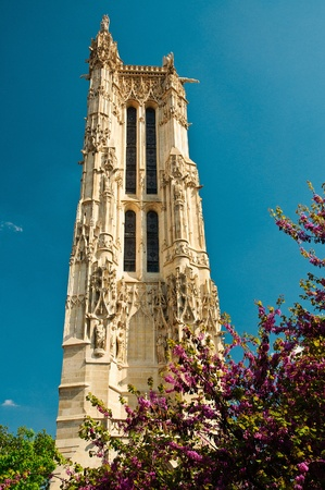 Saint-Jacques church tower in Paris in the Spring with flowers and blue sky Stock Photo