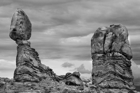 Balanced Rock, Arches National Park, Utah. High contrast black and white with a stormy sky.