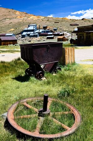 Bodie Ghost Town, showing old gold mining equipment and mine in background Stock Photo