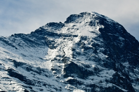 Dramatic and Famous Eiger North Face, Swiss Alps showing summit photo