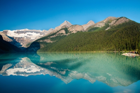 Colorful early morning refelction of Lake Louise, Banff National Par, Canadian Rockies photo