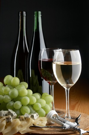 pervaded: grape, cheese and wine on the black background