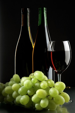 still life with grape and wines on the black background Stock Photo - 1696281